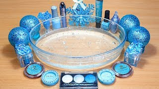 Slime Light Blue Mixing makeup and glitter into Clear Slime