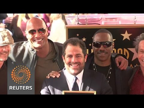 Eddie Murphy and The Rock witness Brett Ratner's Hollywood honor.