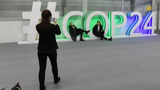 COP24 climate talks yield text after marathon negotiations