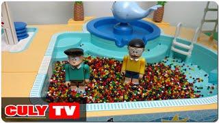 đồ chơi Doremon hài - Nobita chơi tắm hồ bơi bi nước nhiều màu sắc cùng xeko cầu tuột