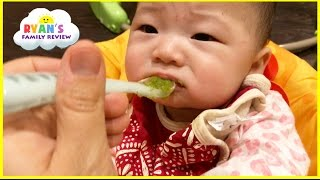 Baby First Time Eating Baby Food gross yucky Face! Twin Babies first solid food! Ryan's Family Vlog