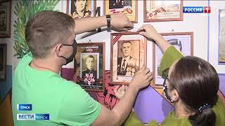 Омичи создали галерею портретов «Бессмертного Полка» в собственном подъезде