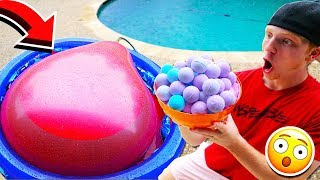 PUTTING 100 BATH BOMBS IN A 6FT WATER BALLOON!