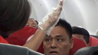 Bad mannered Chinese Man on Airplane
