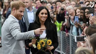 WATCH: Fans shower Meghan Markle with flowers at Trinity College