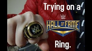 TRYING ON A WWE HALL OF FAME RING.