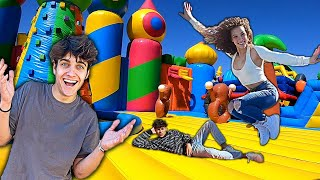 STAYING OVERNIGHT IN A GIANT BOUNCY HOUSE (24 hour challenge)
