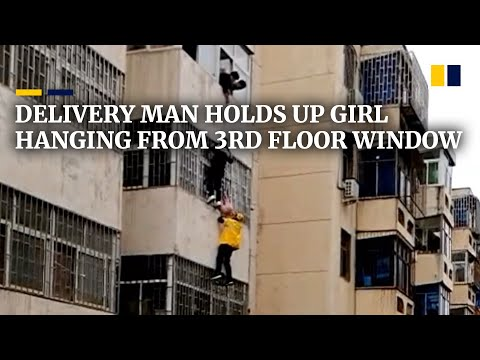 Delivery man climbs onto third floor to hold four-year-old girl hanging from window