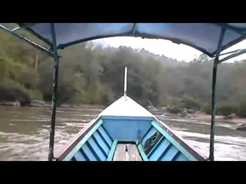 Long tail boat trip visiting hill tribe villages in Thailand