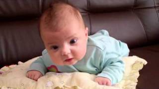 3 months old baby tryies crawling