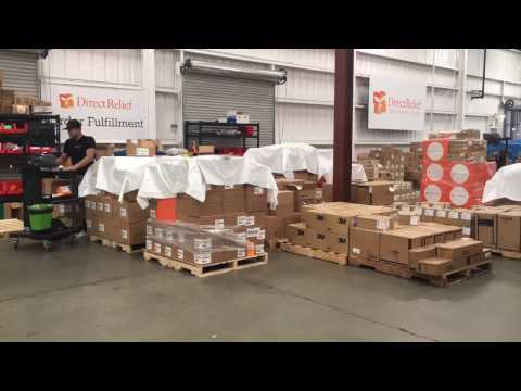 Direct Relief staff preparing emergency medicine and medical supplies for delivery to Peru in response to deadly flooding that has devastated the country in recent weeks.