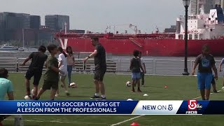 Young soccer players get a lesson from Liverpool F.C.