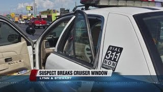 Man tries to escape arrest, kicks police car window out