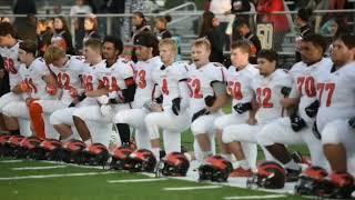 Jackson High School football players take knee before national anthem