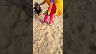 Lakshya playing in sand