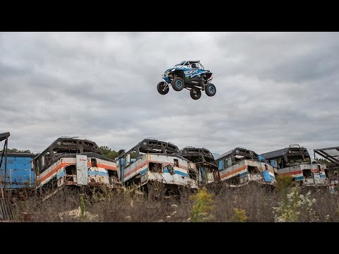 """XP1K3"" is five-minute full throttle, turbo powerd, mind bending, off-road thrill ride through the most unforgivable obstacles imaginable. RJ Anderson fearlessly attacks massive jumps, high speed drifts, and treacherous man-made terrain in his custom 200 horsepower Polaris RZR XP Turbo. XP1K3 was produced by motorsports production powerhouse Mad Media in the post apocalyptic dystopian decay of abandoned steel mills, old factories, and train yards."