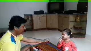 Youngest singer Shona learning classical music.