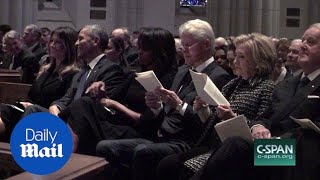 Obama appears to joke with Melania at Barbara Bush's funeral - Daily Mail