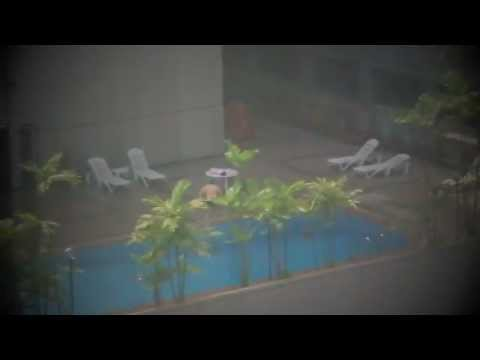 Asian Back flop into pool