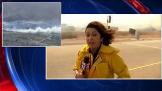 FOX 11 reporter near fast-moving brush fire in Anaheim Hills