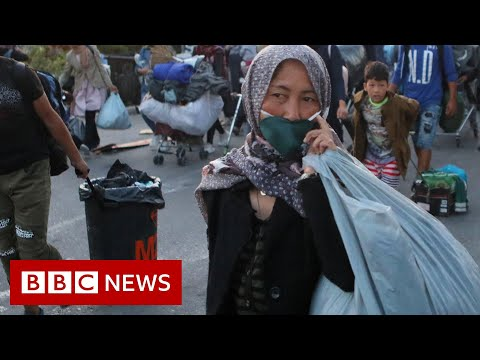 Lesbos: Greek police move migrants to new camp after Moria fire - BBC News