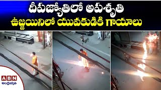 Young man catches fire after acrobatics with fire in Ujjai..