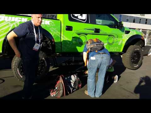 JMC Equipment visits the Quickjack Lifts booth at the SEMA 2016 Show