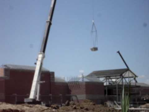 JJ Curran Crane Places Roof Top Units at Walmart