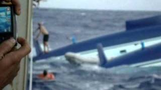 Capsized Atlantic 57 and Rescue by the M/V Forum Pacfic August  2010