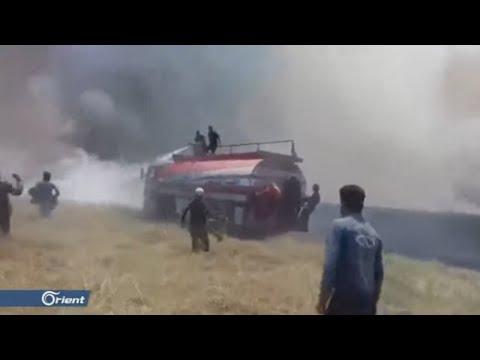عناصر ميليشيا قسد يرقصون على وقع احتراق أراضي الفلاحين في الحسكة - سوريا