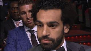 Sergio Ramos looks on awkwardly as Mo Salah talks about his incredible debut season at Liverpool