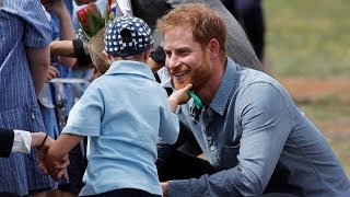 Boy strokes Prince Harry's beard during royal couple's Aus..