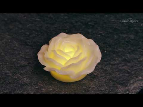 Candela rosa luminosa in cera avorio, led bianco caldo (cod. 35621)