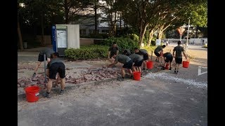 China's PLA soldiers help clean up Hong Kong streets