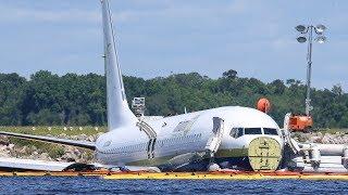 Boeing 737 slides off runway into Florida river