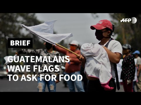 Guatemala's poor use coloured flags to ask for help amid pandemic | AFP photo