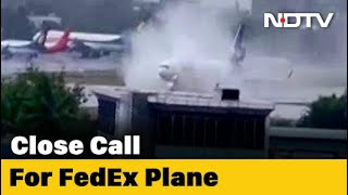 Cyclone effect: FedEx flight skids off runway while landin..
