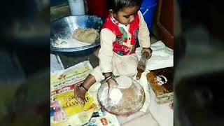 Little cute baby making Roti... Soo cute