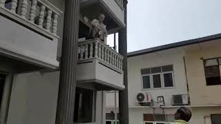 German man saved after threatening to jump from second floor balcony in Pattaya