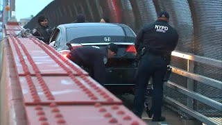 Whoops! Car becomes stuck in pedestrian lane of Pulaski Bridge