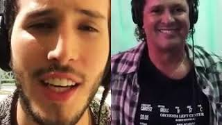 Sebastian y Carlos vives cantando robarte un beso