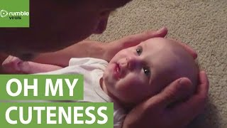 Baby girl has emotional reaction to daddy's singing
