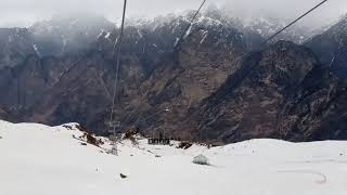 Full view of auli snow covered area, sking place, mountains with chair car ropeway dwnstair bording