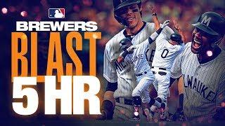 Brewers blast five homers