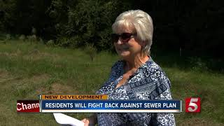 Residents get condemnation letter from county over sewer plan
