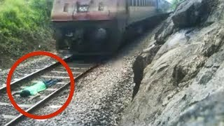 India train stunt: Man risks life lying on railway tracks as train speeds over him