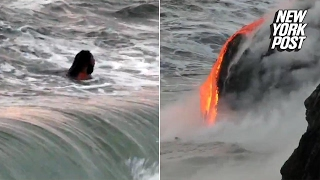 Man swims dangerously close to lava flow in Hawaii