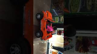 Baby playing with motor car