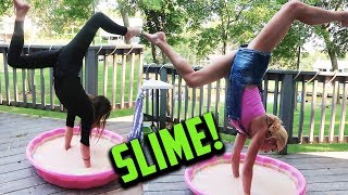 REBECCA AND ANNIE DO HANDSTANDS IN GIANT SLIME! (DAY 248) GYMNASTICS CHALLENGE IRL