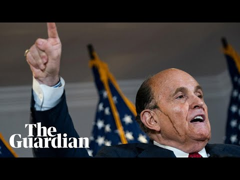 Rudy Giuliani's hair dye runs down his face as he makes baseless voter fraud allegations